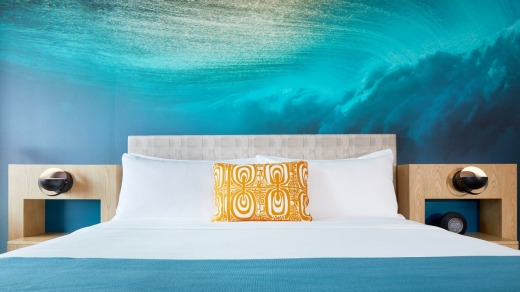 An underwater image by internationally-acclaimed surf photographer Zak Noyle appears behind every bed.