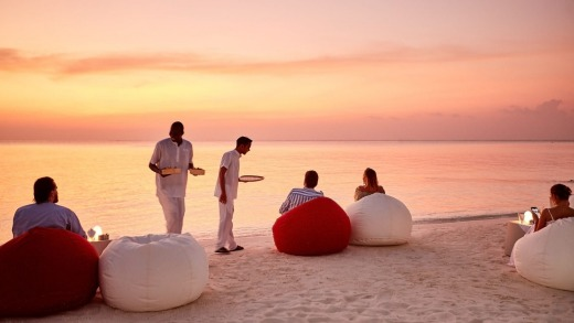 Sunset drinks on the beach at LUX North Male Atoll resort in the Maldives.