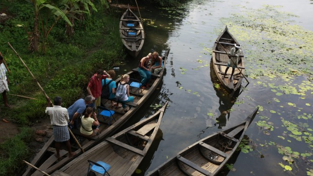 Exploring the backwaters in a traditional thoni canoe.