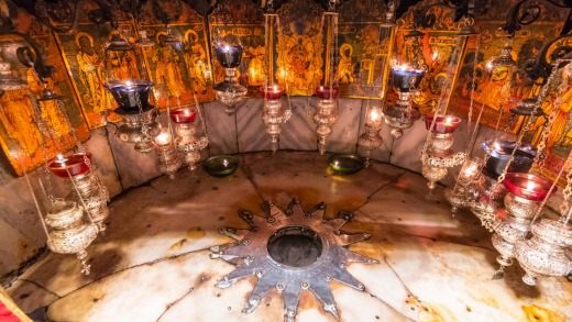 A silver star marks the traditional site of teh birth of jesus in a grotto underneath Bethlehem's Church Of The ...