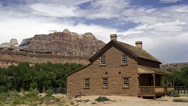 The John and Ellen Woods homestead from the 1850's in the Ghost Town of Grafton, Utah with buttes in background  ...