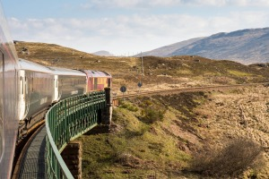 The Caledonian Sleeper train crosses Rannoch Viaduct in the Scottish Highlands.