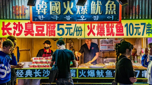Night market street food stalls at Sanxiajiu Pedestrian street in the downtown area.
