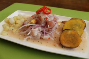 Ceviche with corn and sweet potato slices.