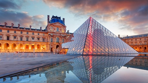 The Louvre Museum and the Pyramid at sunrise.