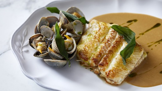 Siren's Dover sole with cockles, clams and clotted cream sauce.