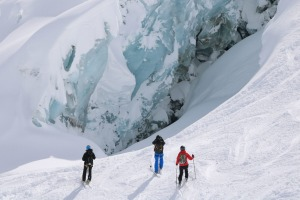 Skiers admiring the ice forms on the walls of the Vallee Blanche.