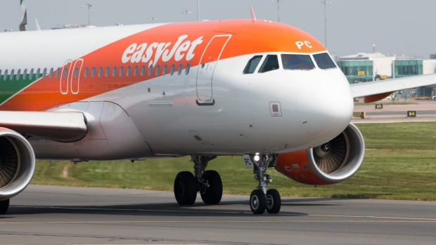 A passenger stepped up to fly an easyJet plane after a pilot shortage caused a delay.
