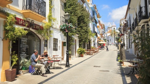 A side street in Marbella Old Town with bars and restaurants.
