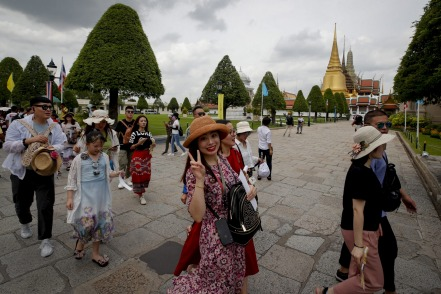 Chinese tourists visit the Grand Palace in Bangkok, Thailand, pre pandemic.