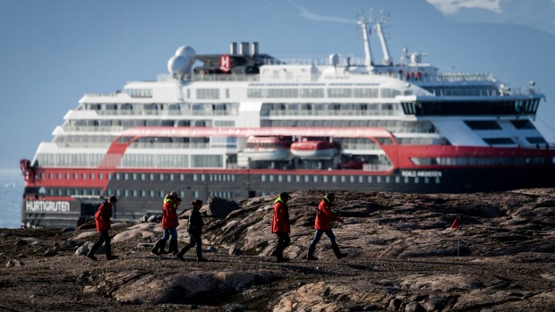 As Greenland's ice melts, MS Roald Amundsen, the world's first hybrid cruise ship, launches.
