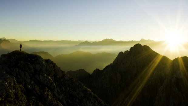 Two in one: Climbing mountains and seeing the sunrise are far more fun to look back on than to actually do.