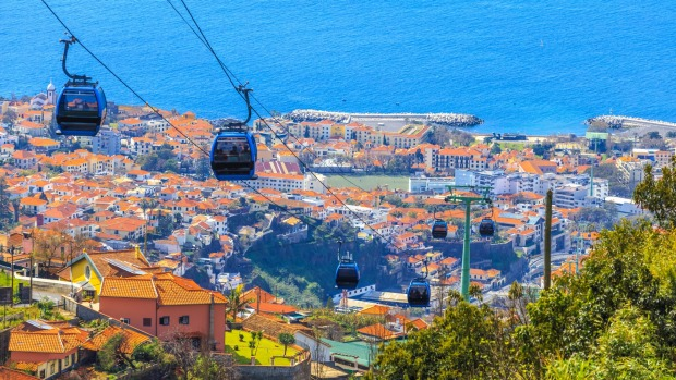 Cable cars above the city of Funchal.