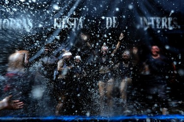 People painted with black grease celebrate during the traditional festivities of the Cascamorras festival in Baza, ...