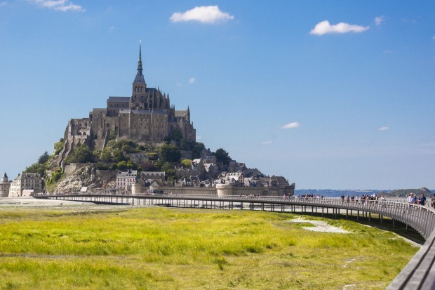 Mont St Michel: The huge carpark on the mainland gives you an idea of how many tourists visit the iconic island of ...