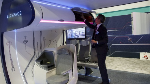 Ingo Wuggetzer, vice president of cabin marketing at Airbus, demonstrates smart sensor technology to detect carry-on ...