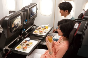 Passengers enjoy economy seating on Japan Airlines.