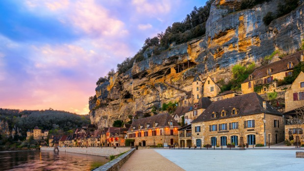 La Roque-Gageac, one of the most beautiful villages of France (Les Plus Beaux Villages), in dramatic sunset light.