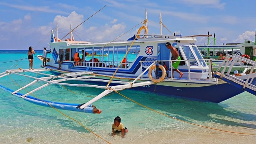 One of the bangkas - traditional Filipino fishing boats - bringing tourists to Puka Beach, Boracay.