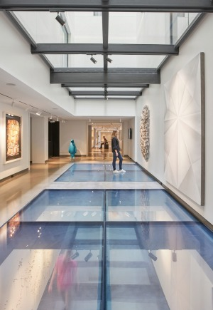 Nashville's 21C Museum Hotel incorporates light-filled, glass-floored exhibition spaces and installations.