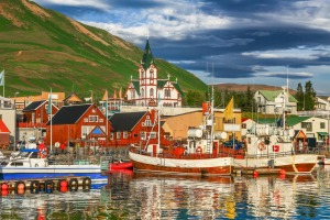 Husavik in Iceland. Collette has an eight-day tour that combines an overland exploration of Iceland with a cruise along ...