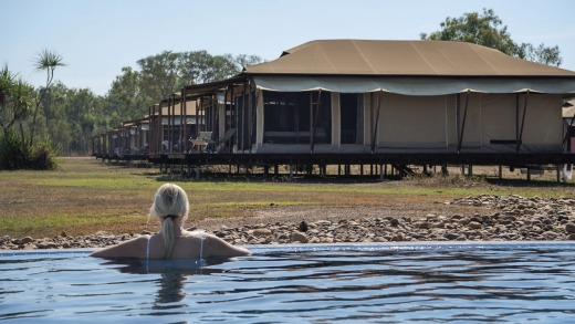 Relaxing in the pool at the Wildman Wilderness Lodge in the majestic Mary River National Park Wetlands of the Northern ...