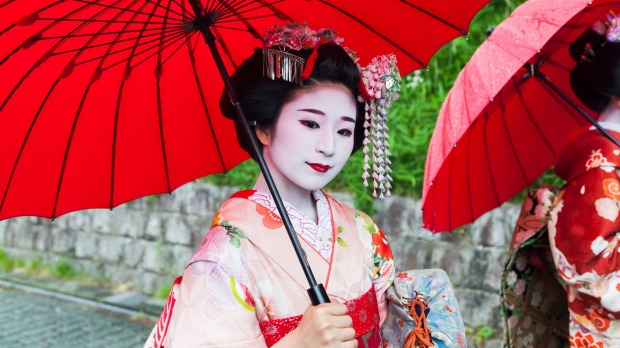 Geishas have been mobbed by tourists trying to get photos of them in Kyoto.