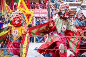 Masked dancers perform at Hemis Monastery.