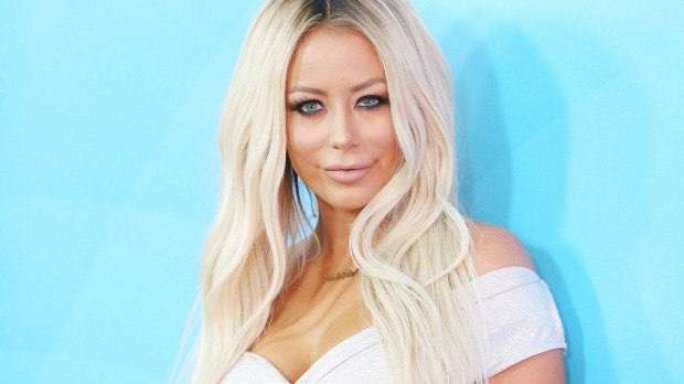 Aubrey O'Day claims an American Airlines flight attendant made her remove her shirt in front of other passengers.