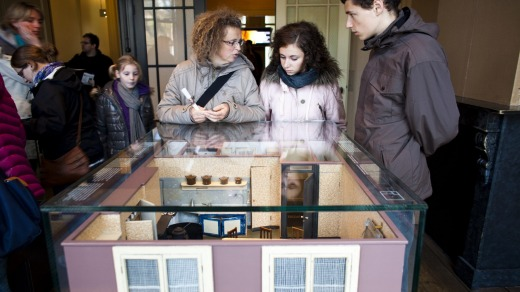 Visitors look at scale models of the secret annex.
