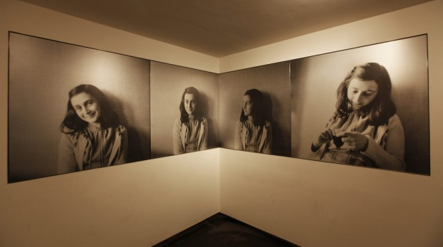 Portraits of Anne Frank in the introduction room.