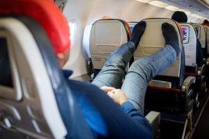 Man relaxing and sleeping during flight Getty image for Traveller. Single use only. tra30-online-passengers Annoying ...