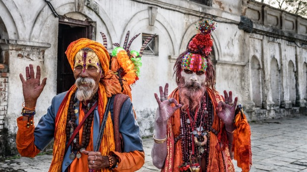 Wandering  Shaiva sadhus (holy men) with traditional body painting in ancient Pashupatinath Temple.