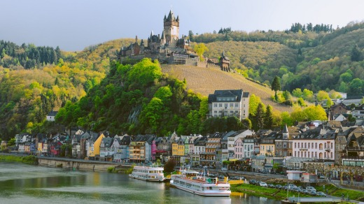 Reichsburg Imperial Castle crowns the hill above Cochem on the Moselle River in Germany.