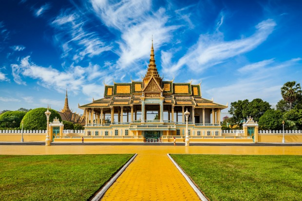 PHNOM PENH'S ROYAL PALACE  The walled palace with its classic golden Khmer gables, set at the confluence of three great ...