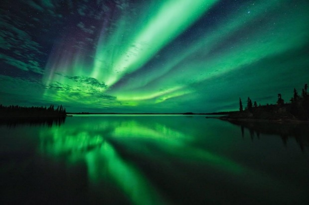 Yellowknife has a long aurora season, meaning you can capture reflections of the northern lights in the unfrozen lake ...