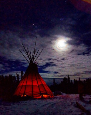Guests can await the arrival of the lights in by the warmth of a fire inside a teepee.