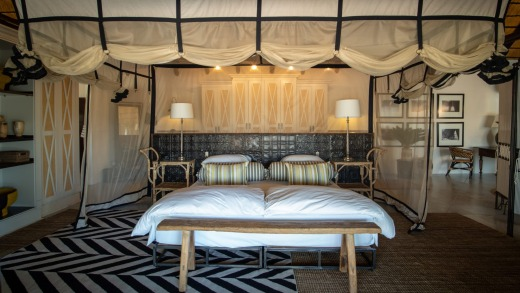"""The """"African luxe"""" aesthetic of a Villa Mushara bedroom."""