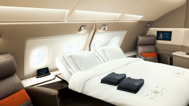 The first-class suites feature a sliding door and double-bed option for the first two suites in the aisle.