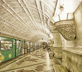 Belorusskaya Metro Station opened in 1952. The station features white marble pylons, elaborate patterned plaster ...