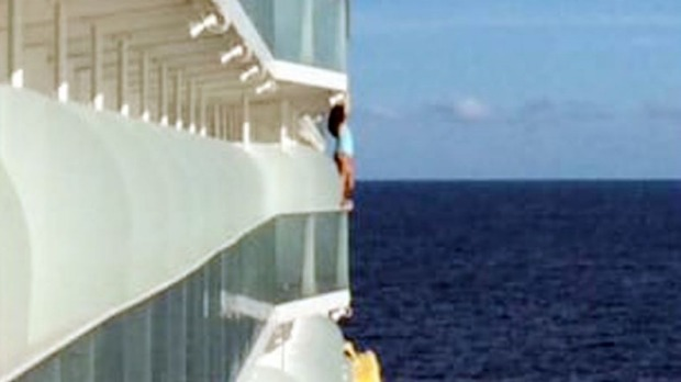 An unidentified woman was spotted posing on the edge of the ship in a swimsuit while travelling through the Caribbean.
