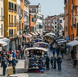 Pedestrians walk beside market stalls in Rio Tera San Leonard, in the Cannaregio district of Venice.