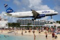 JetBlue flying into St. Maarten, Antilles.