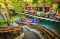 People dine at restaurants along The Riverwalk, a scenic canal of the San Antonio River, in downtown San Antonio, Texas.