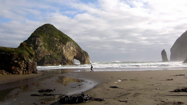 Chiloe's west coast is a place of empty beaches surrounded by rugged coastal forest and mountains.