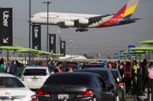Passengers wanting to use ride-share services at LAX will now need to take a bus to a special pick-up area.
