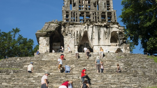 Visitors clamber up the Templo del Sol in Palenque.