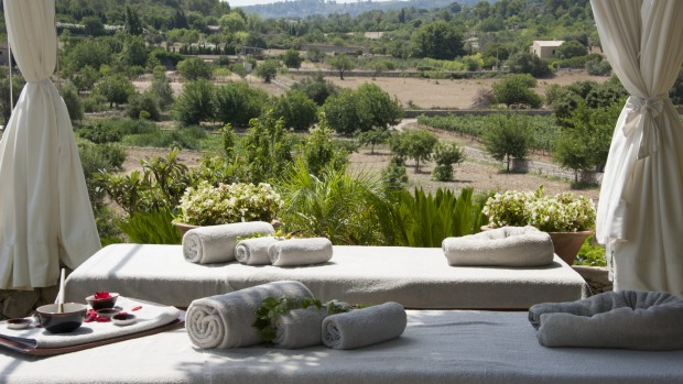 The heated infinity pool is surrounded by daybeds and the sunny terrace has views across an ancient olive grove.