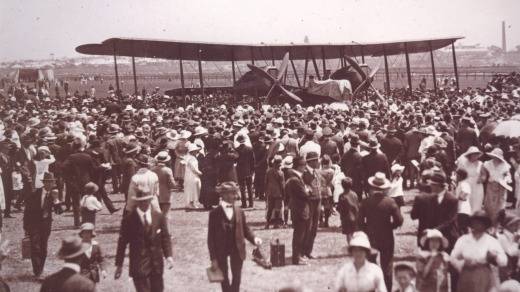 The Smith brothers' Vickers Vimy biplane greeted by a crowd at Mascot Aerodrome, 14 February 1920.