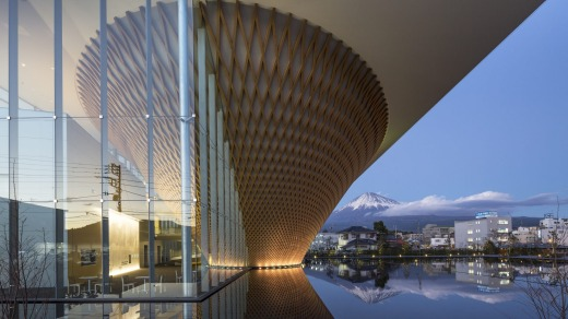 Inside the latticework cone, a white 193-metre spiral ramp simulates the experience of climbing Mount Fuji.